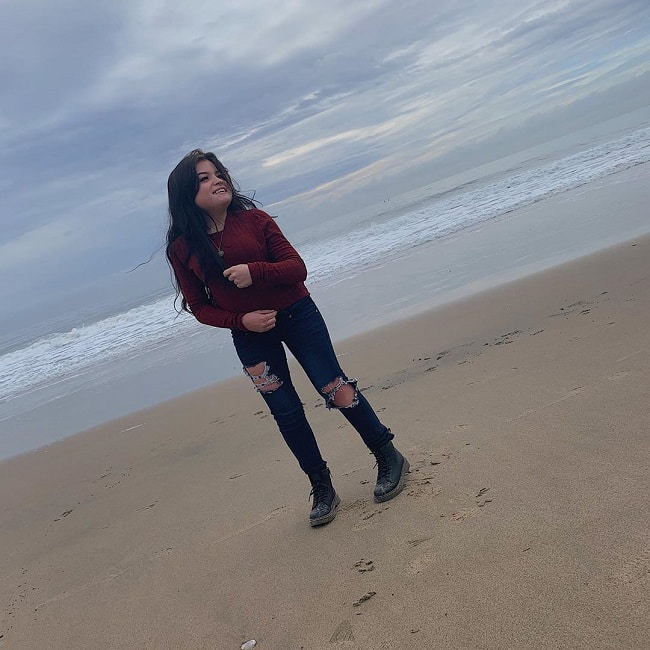 Taylor Reilly posing for photo in Twin Lakes States Beach