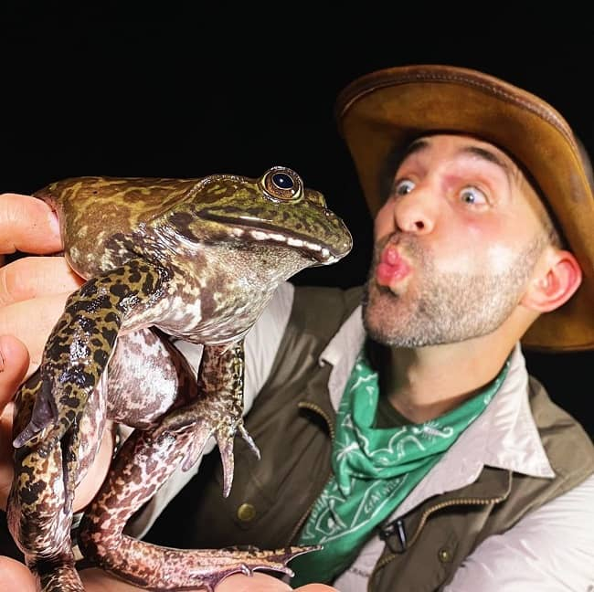 Coyote Peterson with a frog